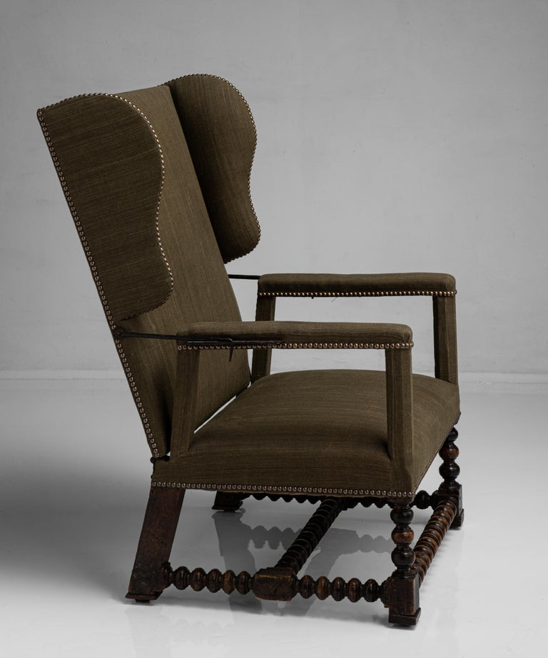 """Walnut reclining armchair France circa 1780  Newly upholstered, with bobbin turned legs and stretcher. Original reclining metalwork with four wrought iron pins and hole settings to each arm.  Measures: 27"""" W x 22"""" D x 41"""" H x 14""""seat."""