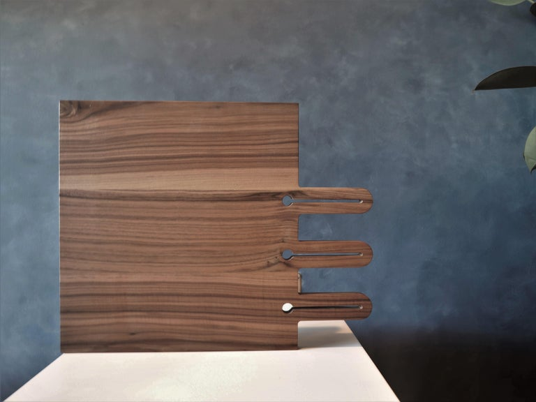 Walnut serving tray finished with a food safe oil wax. Can be used as a serving tray and a cutting board.
