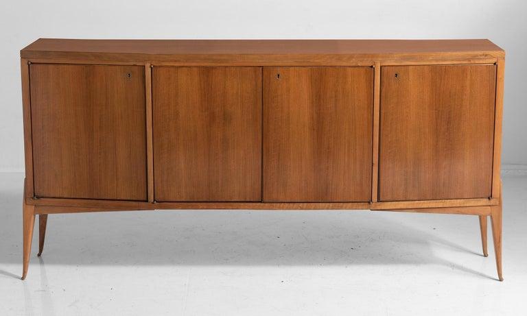 Elegant modern sideboard with polished walnut surface.