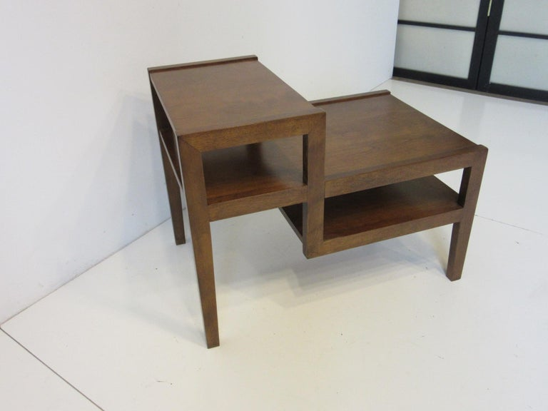 A solid maple step styled side table in a dark walnut finish in a simple yet balanced design typical of the work of Leslie Diamond. Well crafted by the Conant Ball furniture company from their Modern Mates collection.