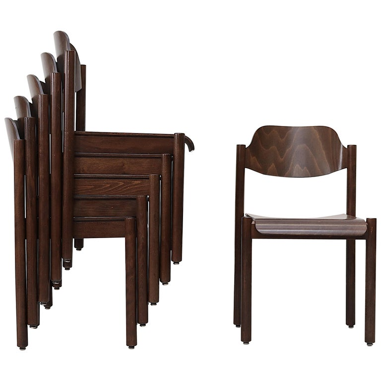Walnut Toned Vico Magistretti Style Stacking Chairs For Sale