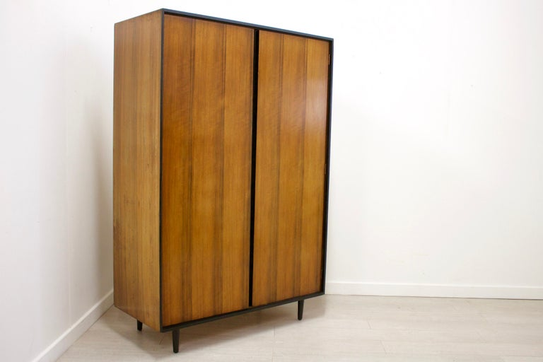 This is a very stylish walnut wardrobe by John & Sylvia Reid for Stag. Features a mirror on the inside of the right door, a hanging rail to the left and shelves to the right for ample storage.