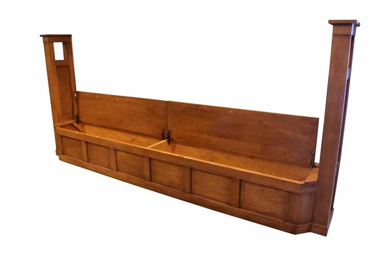This wonderful walnut window seat with end posts doubles as seating and as storage space, as the two seat areas open up to reveal large storage space underneath. This window set is made of beautiful walnut woodwork and is in great condition! This