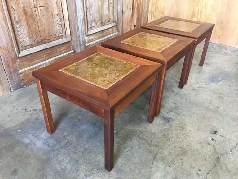 Set of three walnut with copper tile top tables by John Keal for Brown Saltman.