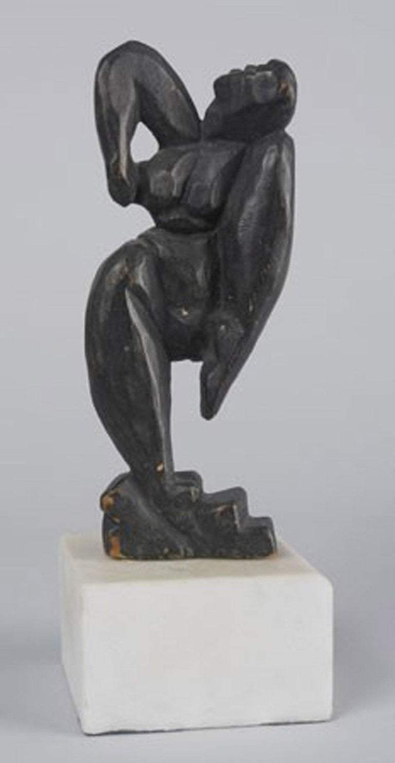 Unsigned  Inspired by  Alexander Archipenko, Blue Dancer and Henri de Toulouse-Lautrec, Loie Fuller color lithograph  Wood carving with pigment  Note: Kuhn's sculptures were collected by the noted early modernist collector John Quinn (1870-1924).