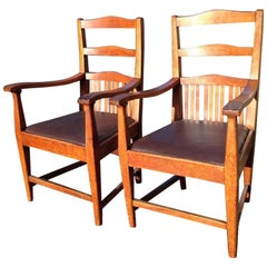Walter Cave Attri. a Pair of Arts & Crafts Oak Armchairs with Curvaceous Backs