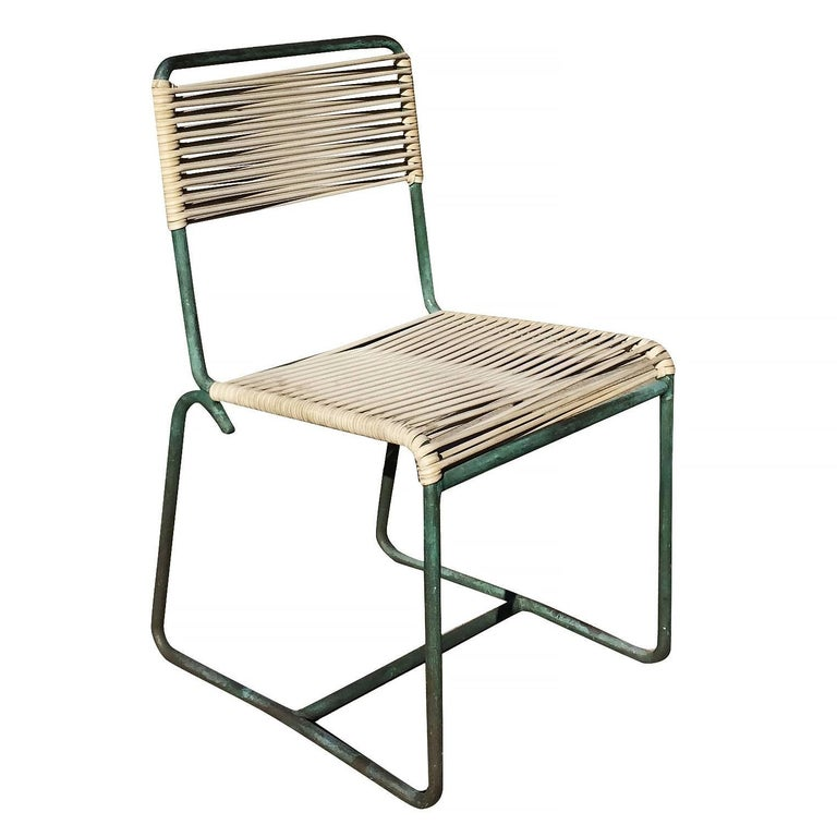 Set of four outdoor/patio tubular bronze frame chairs with cloth cording seat and back with a verdigris bronze finish.