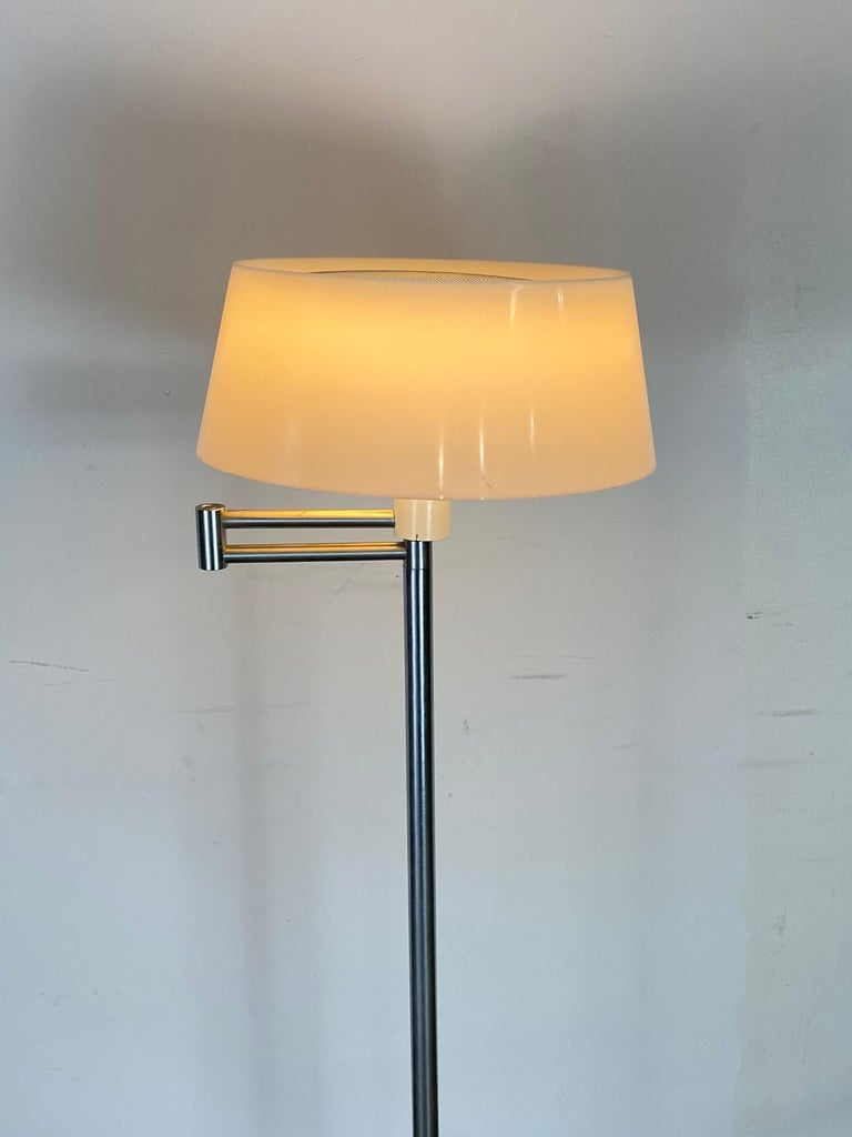 Heavy floor lamp designed by Walter Von Nessen. Original plastic molded shade with perforated screen insert at top. The top screen provides a gorgeous effect when illuminated. Tested and working.