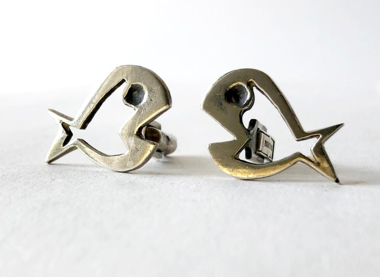 Sterling silver modernist fish cufflinks by Walter Wright, circa 1950's.  Cufflinks measure 3/4