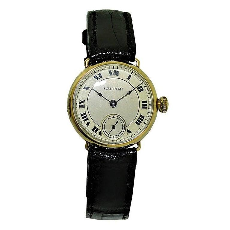 FACTORY / HOUSE: Waltham Watch Company STYLE / REFERENCE: Art Deco / Campaign Style  METAL / MATERIAL: 14Kt. Solid Gold CIRCA: 1918 DIMENSIONS: 28mm X 27mm MOVEMENT / CALIBER: Manual Winding / 17 Jewels / Cal. Ruby Series DIAL / HANDS: Two Tone