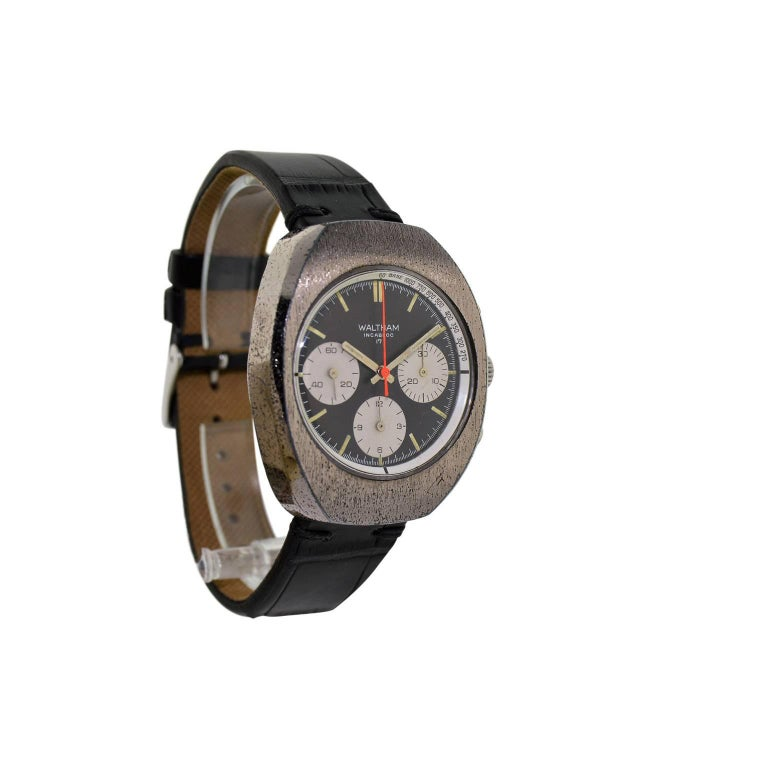 FACTORY / HOUSE: Waltham Watch Company STYLE / REFERENCE: Chronograph / Sports Style METAL / MATERIAL: Chromium on Bronze CIRCA: 1960's DIMENSIONS: 46mm X 38mm MOVEMENT / CALIBER: Manual Winding / 17 Jewels  DIAL / HANDS: Original Black and Silver /