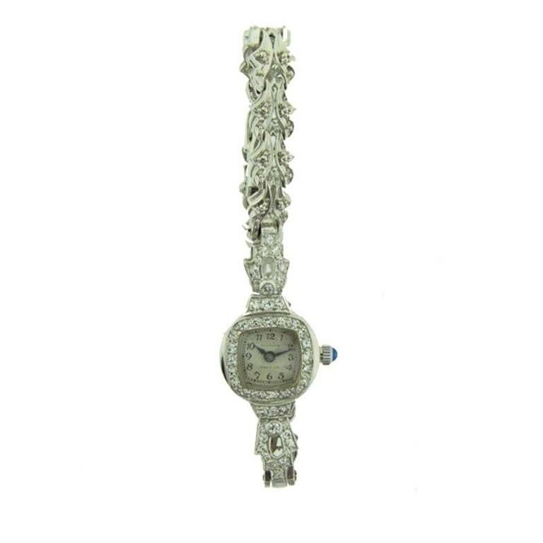 FACTORY / HOUSE: Waltham Watch Company STYLE / REFERENCE: Art Deco / Dress Style METAL / MATERIAL: Platinum with White Gold Bracelet CIRCA: 1940's DIMENSIONS: 19mm X 15mm MOVEMENT / CALIBER:  17 Jewels / 670 Caliber DIAL / HANDS: Original Silvered