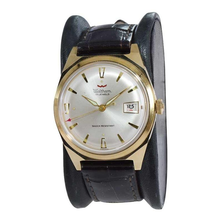 FACTORY / HOUSE: Waltham Watch Company STYLE / REFERENCE:  Art Deco METAL / MATERIAL: Yellow Gold Filled DIMENSIONS:  45mm  X  35mm CIRCA: 1950's MOVEMENT / CALIBER: 17 Jewels / Manual Winding DIAL / HANDS: Original Silver / Dauphine  ATTACHMENT /