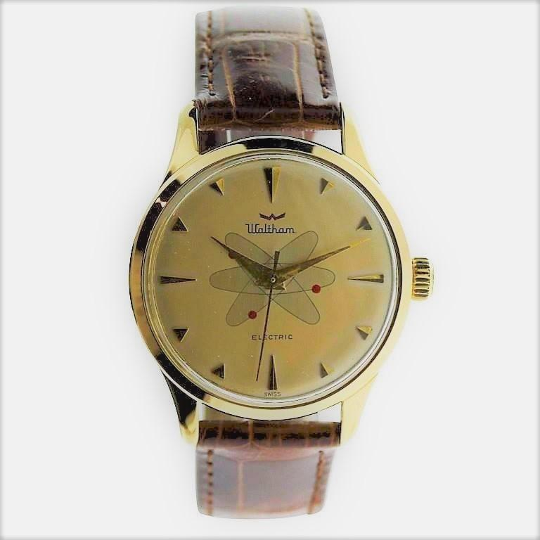 FACTORY / HOUSE: Waltham Watch Company STYLE / REFERENCE: Round / Space Age Design METAL / MATERIAL: Yellow Gold Filled CIRCA: 1950's / 1960's DIMENSIONS: 44mm X 35mm MOVEMENT / CALIBER: Electromechanical / Battery Driven Balance Wheel / 17 Jewels