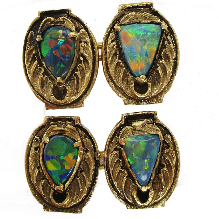 These awesome cufflinks are signed by Walton & Co and in mint condition! They are marked 14 karat yellow gold and feature centerpieces of seven colored solid black opal in a magnificent abstract owl pattern. The detailing on these is incredible, and