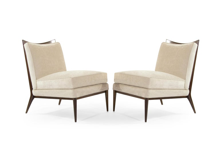 Exceptional pair of chairs designed by Paul McCobb for Directional, circa 1950s.  Newly upholstered in taupe velvet, walnut framed fully restored.