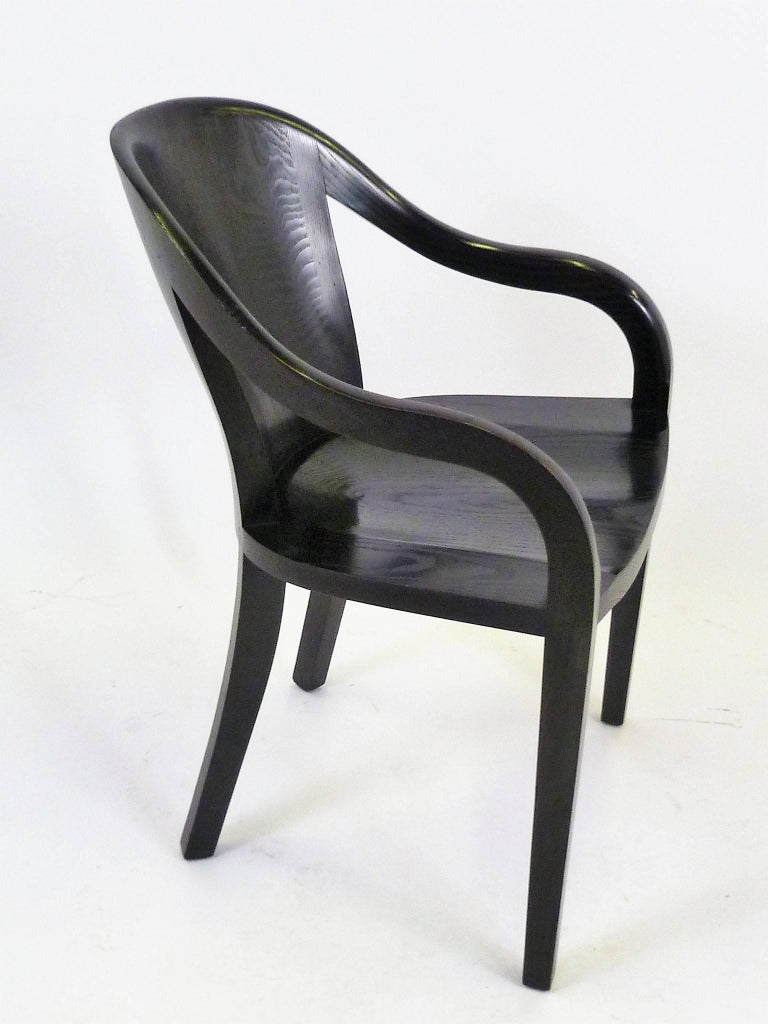 With a 1984 tag from Brickel Associates, this Ward Bennett chair named The 1550 University carved-wood frame armchair was first designed in 1970 for the LBJ Library at the University of Texas, in Austin. Johnson requested that the seat evoke a cross