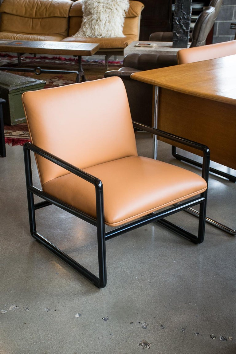 Pair of refined chairs by midcentury designer, Ward Bennett for Brickel. Black lacquered frames with camel colored leather seats and backs. Label intact, 1960s.