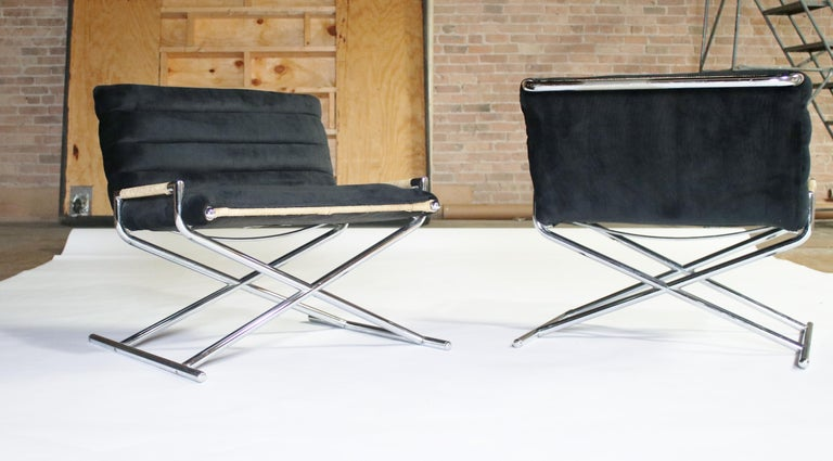 Pair of upholstered and rattan sled chairs on chrome frame by Ward Bennett for Brickell, 1984. Labelled.
