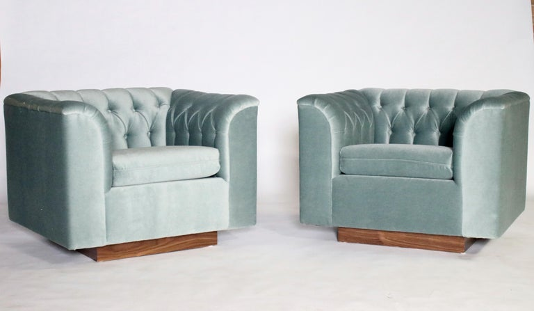 Pair of Ward Bennett cube shaped club chairs on walnut plinths newly upholstered in steel blue gray tufted mohair.