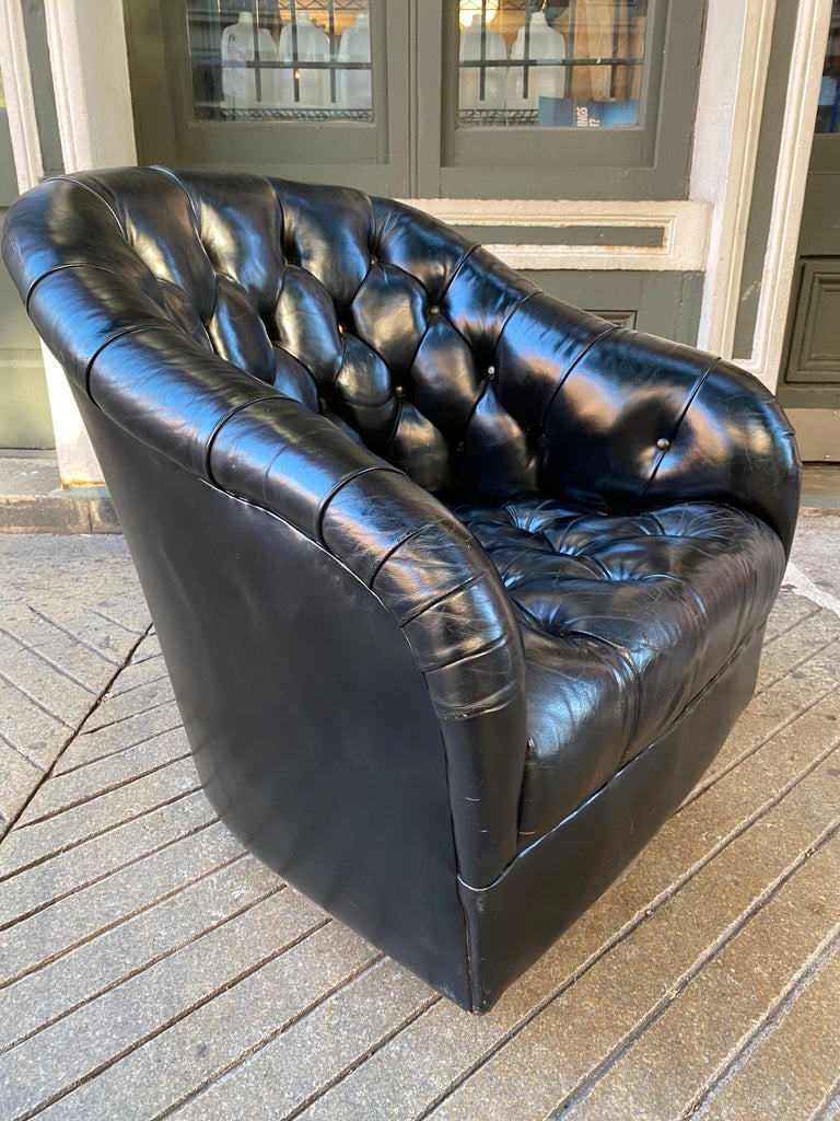 Ward Bennett for Brickel tufted black leather swivel chair. Beautiful black leather with just the right amount of patina! Very comfy, sink into this luxurious chair and swivel!