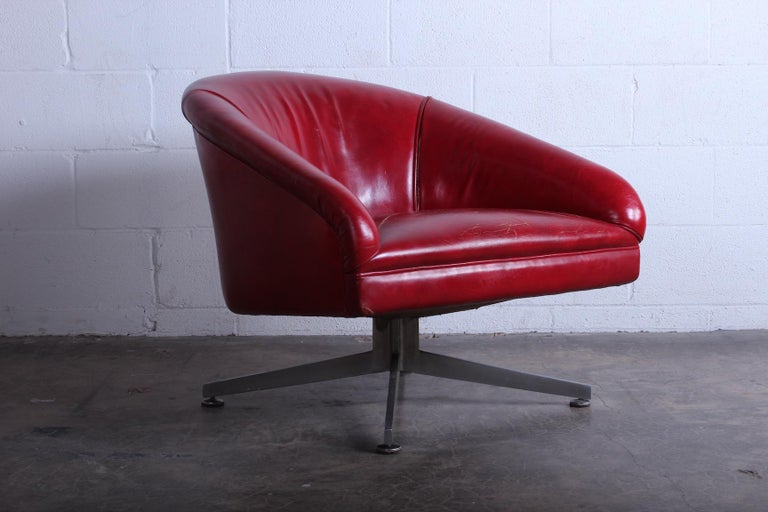 A Classic Ward Bennett lounge chair on aluminum base. The original leather has splits in the seams.