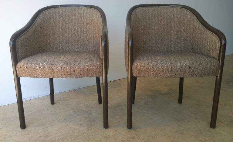 Offered is a signed pair of Mid-Century Modern Ward Bennett for Brickell and Associates armchairs lacquered in dark brown with brown and cream original wool herringbone. The wood barrel frame was professionally lacquered in brown a few years back