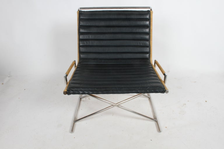 Striking all original Ward Bennett Sled chair with rattan, chrome frame and leather seat. Classic Bennett design with x form base. Minor wear to leather as to be expected, rattan is solid, tight and strong. Note: Front cap on left side front will be