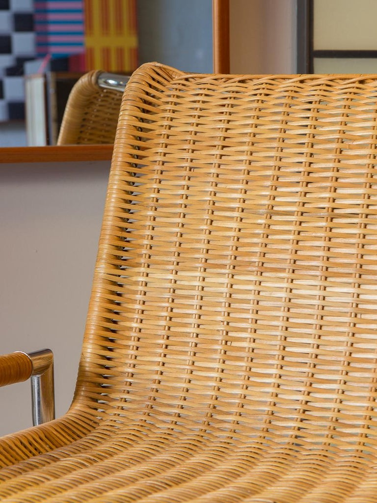 The Sled lounge chair designed by Ward Bennett for Brickel. An amazing 1960s accent chair. This wide chair design features woven cane seating and sleek tubular chromed steel. The X-shaped steel is welded to parallel rails like the familiar sled