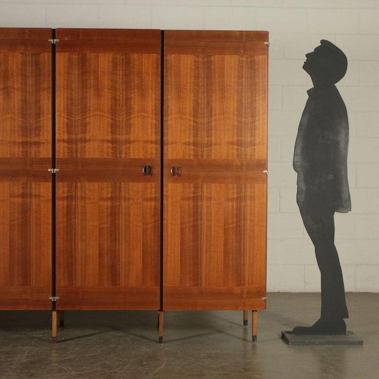 Wardrobe, walnut veneer, wood handles, 1960s.