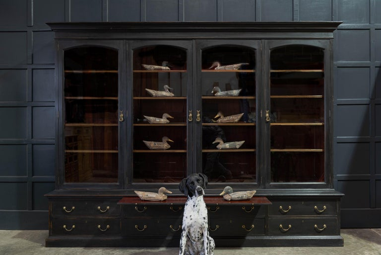 Waring & Gillows glazed ebonised mahogany bookcase circa 1897-1903.  Superb quality Waring & Gillows 4 door glazed ebonised bookcase - Stamped 'Warings Oxford st London W'. Solid mahogany with original heavy hand blown glass glazed doors, 1 master