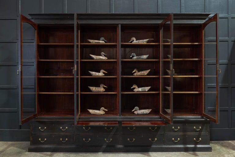 British Waring & Gillows Glazed Ebonised Mahogany Bookcase For Sale
