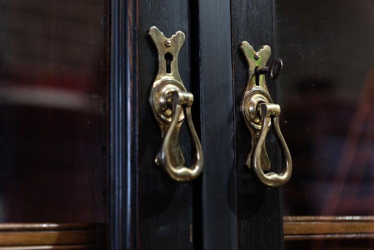 Waring & Gillows Glazed Ebonised Mahogany Bookcase For Sale 3