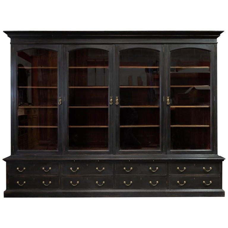 Waring & Gillows Glazed Ebonised Mahogany Bookcase For Sale
