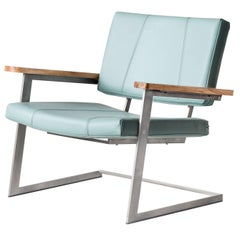 Warren Lounge in Leather, Wool, American Hardwood and Brass