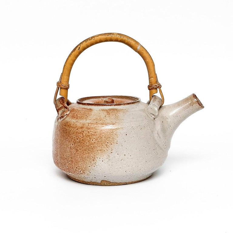 """Warren MacKenzie Shino Teapot clay and glaze 8 x 8.5 x 5.25"""" circa 1980 stamped with the makers mark  Warren MacKenzie (1924 - 2018) is recognized as a true master of 20th Century ceramic art. Through his traditional wheel-thrown vessels, Mr."""
