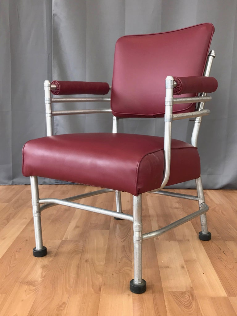 A rare mid-1930s Art Deco aluminum armchair by important American designer Warren McArthur.  Displays McArthur's signature Streamline Moderne-meets-Machine Age aesthetic, with a painstakingly crafted multi-piece anodized aluminum tubular frame over