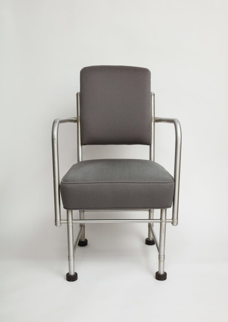 A rare Art Deco Machine Age aluminum armchair by important American designer Warren McArthur. Displays McArthur's signature Streamline Moderne-meets-Machine Age aesthetic, with a painstakingly crafted multi-piece anodized aluminum tubular frame over