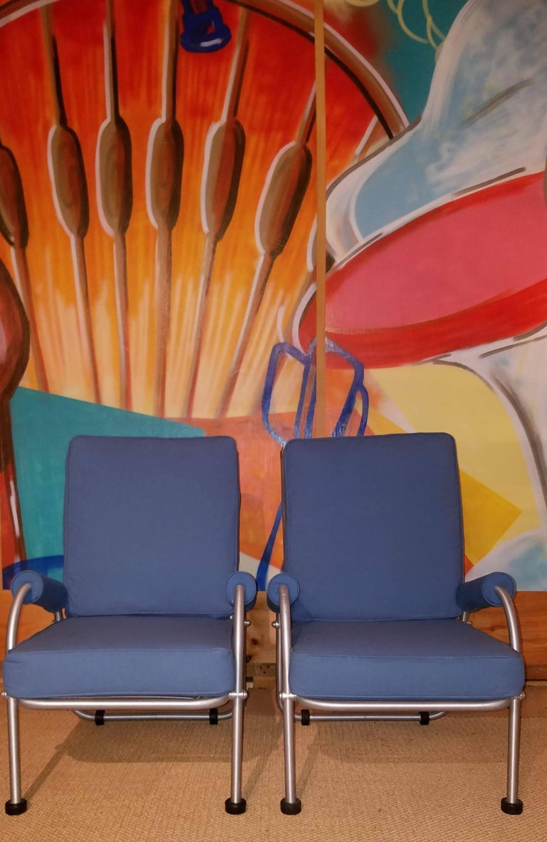 Warren McArthur suite of four lounge chairs circa late 1930s. These seldom seen examples retain their original finish to their tubular aluminum frames. They have been newly upholstered in a blue duck as originally offered by Warren McArthur and
