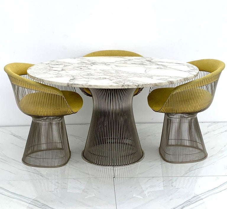 A truly stunning dining table, Warren Platner for Knoll polished nickel and steel base dining table with a stunning veined Italian Arabescato marble top. This original 1960's dining table came from a Scottsdale estate with 1 owner where it sat until