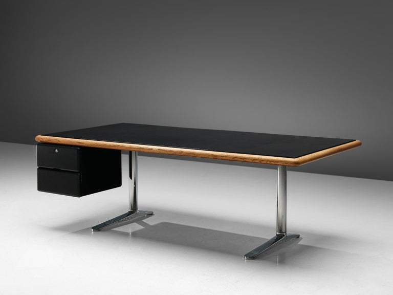 Warren Platner for Knoll, executive desk,leather, steel, oak, metal, United States, 1973.  This heavy, sturdy desk is designed by the American modernist Warren platner. He is most known for his airy metal, sculptural lounge chairs. Perhaps it is