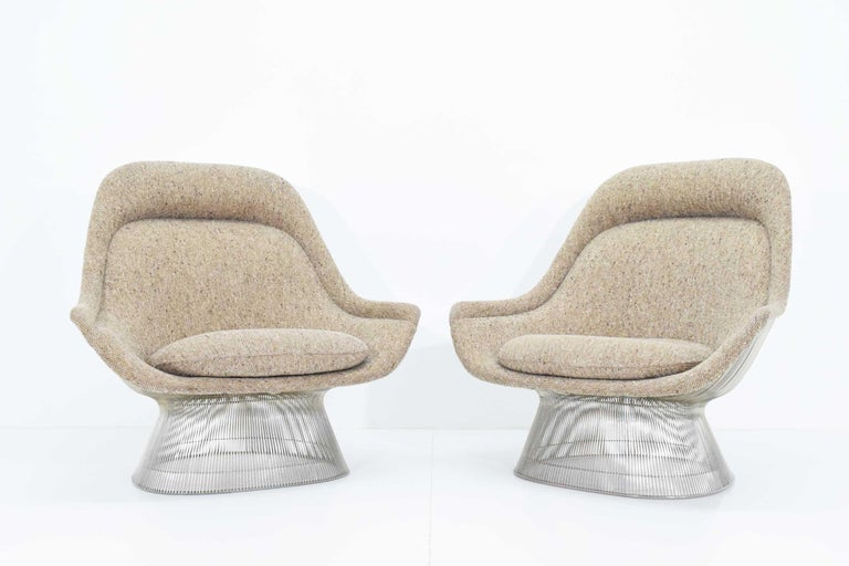 Beautiful pair of large Warren Platner lounge chairs in a beige wool tween that appears to be the original fabric. Chairs are nickel-plated and date 1980s. They are in beautiful condition.