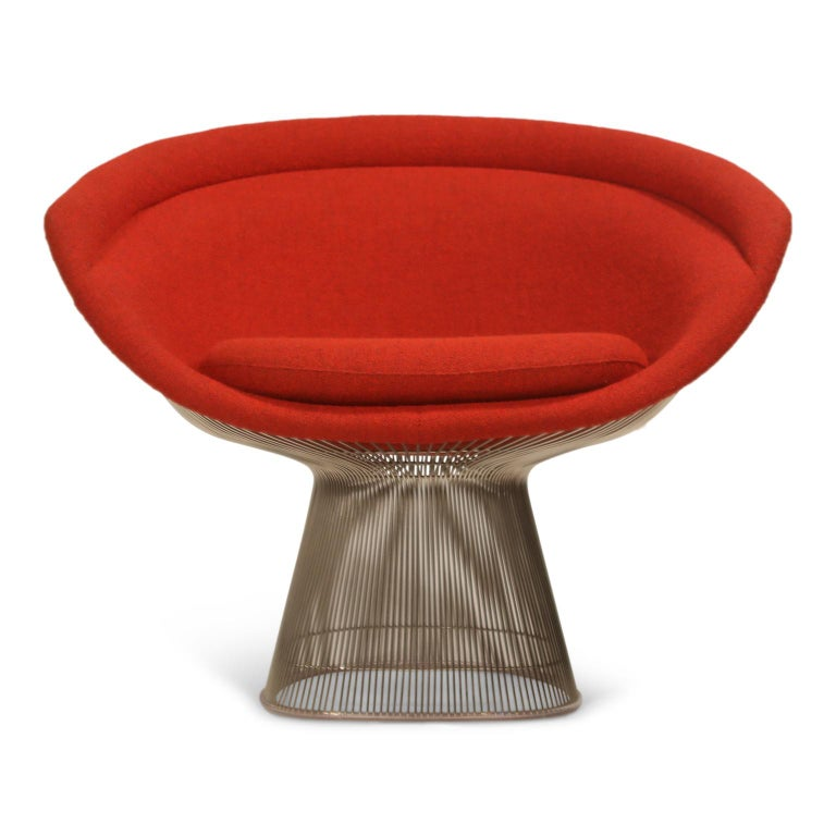 This near-mint condition set of four (4) Warren Platner for Knoll lounge chairs (Model 1715L) are upholstered in a gorgeous red wool boucle fabric over a nickel plated polished steel frame. The nubby red boucle fabric is a beautiful upgrade over the