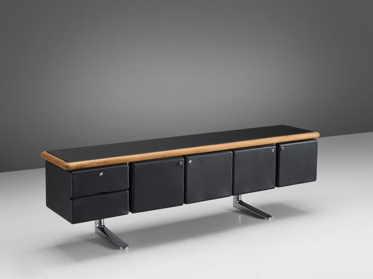 Warren Platner for Knoll, sideboard, chrome, oak, leather, United States, 1973  This sideboard is designed by American modernist Warren Platner. He is most known for his airy metal, sculptural lounge chairs. Perhaps it is surprising that this