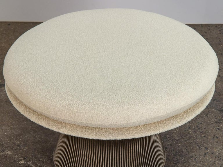 Oversized steel wire ottoman in bouclé, designed by Warren Platner for his namesake Platner collection for Knoll. Now a Classic modern form that is at once Industrial and organic. Upholstered in a creamy Knoll pearl wool bouclé. In excellent