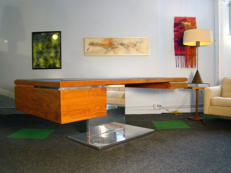 Magnificent midcentury executive desk by Warren Platner for Lehigh-Leopold / Litton (USA) in teak veneers, walnut solids, leather and polished stainless steel. Designed in the late 1960s, this example was made to order in 1983 at a cost of