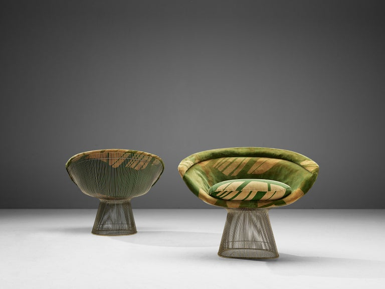 Warren Platner, set of two lounge chairs, metal and yellow-green fabric, United States, 1966.   This iconic set by Warren Platner (1919-2006) is created by welding curved steel rods to circular and semi-circular frames, simultaneously serving as