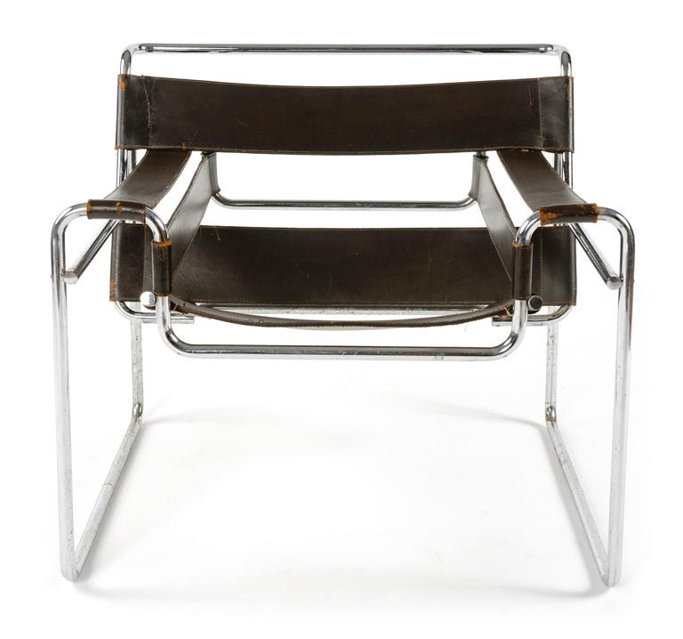 A Classic Mid-Century Modern Minimalist lounge chair in black leather with a seamless tubular chrome frame. Originally from the Levy House in Princeton, NJ, designed by Marcel Breuer, circa 1953. Model B3.