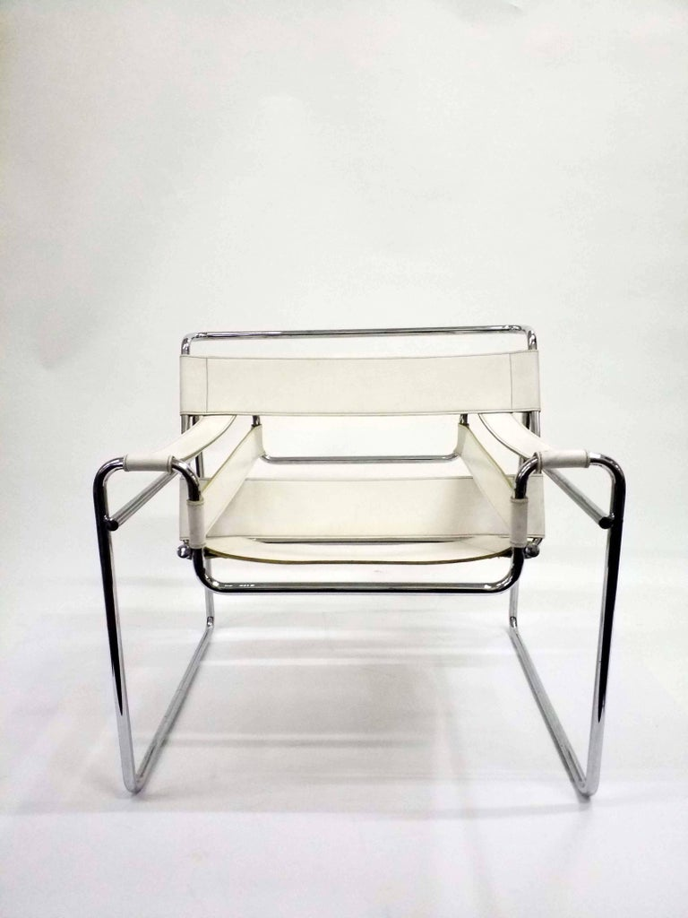 The original model B3, these high quality Wassily armchairs, design by Marcell Breuer were possibly produced by Gavina in the 1960s-1970s period. Strong white leather and chrome-plated body, these iconic pieces fit any interior.