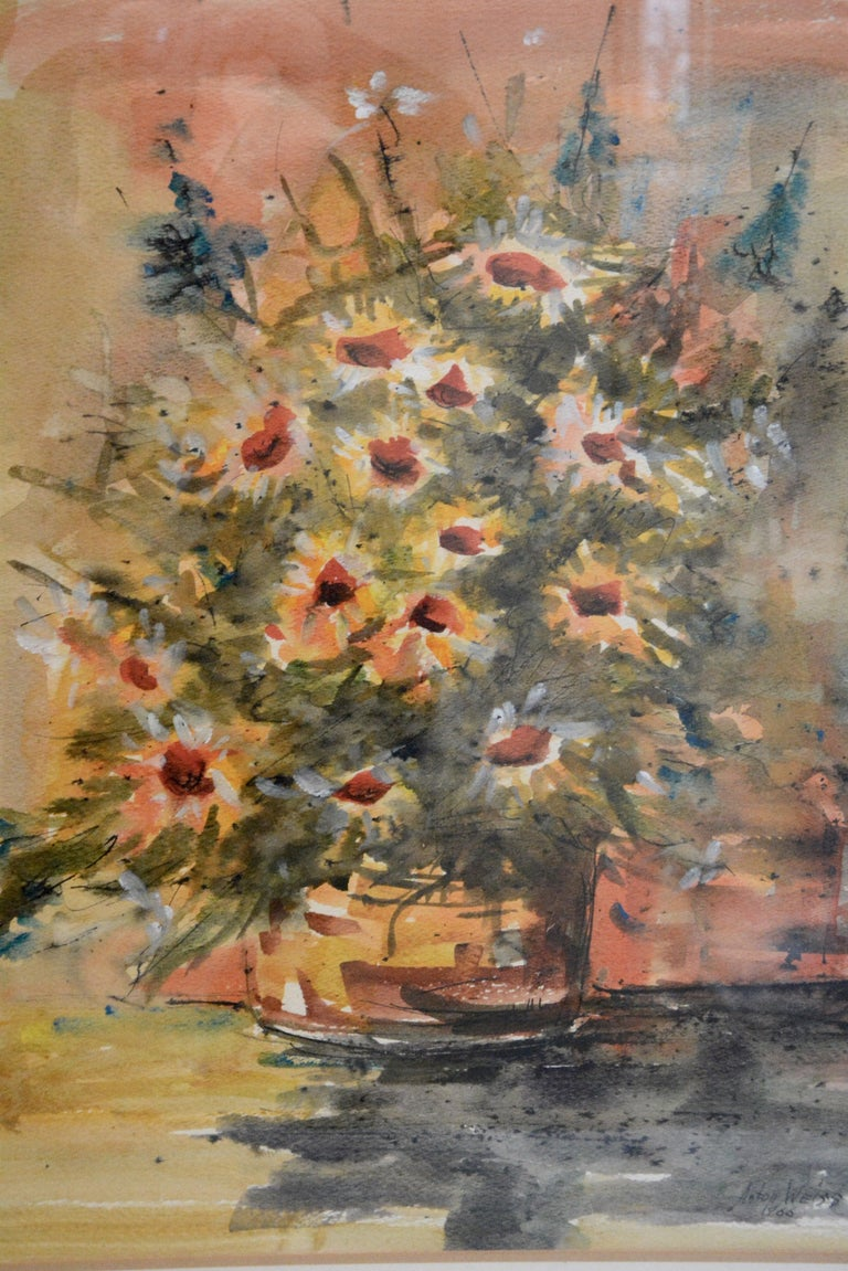The beautiful flowers in this watercolor painting will be a lovely addition to your decor. The painting was created by famous Abstract Expressionist artist, Anton Weiss in 1966. The artwork is enclosed in a wooden frame with a paper mat and covered